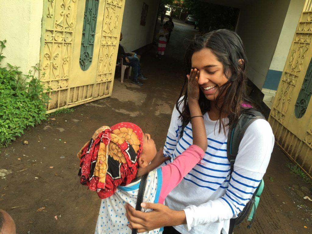 Child touching face of Riyanka Ganguly